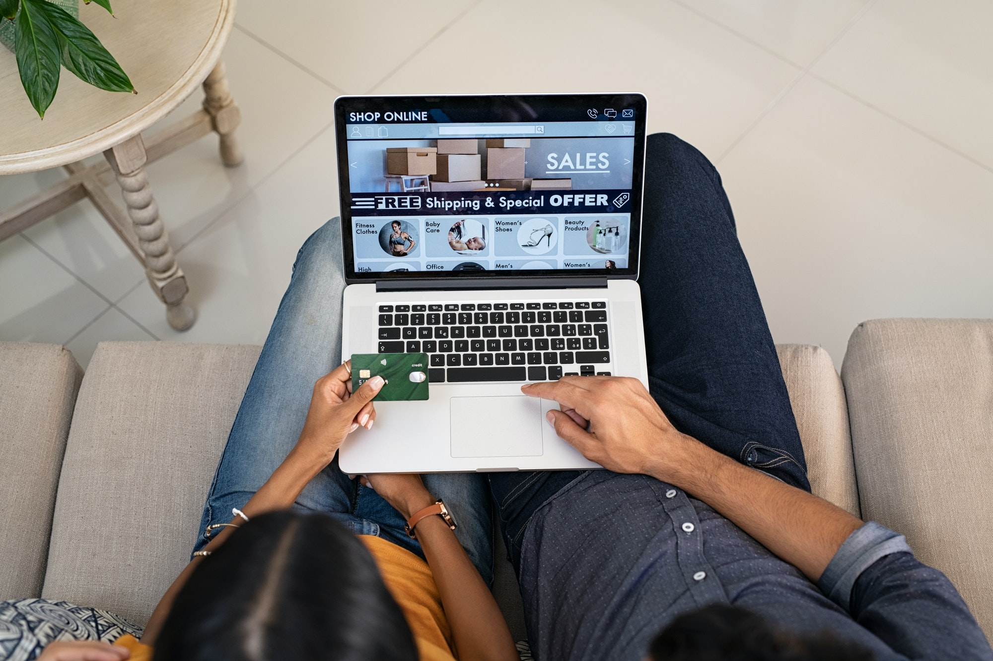 Couple doing shopping online with credit card
